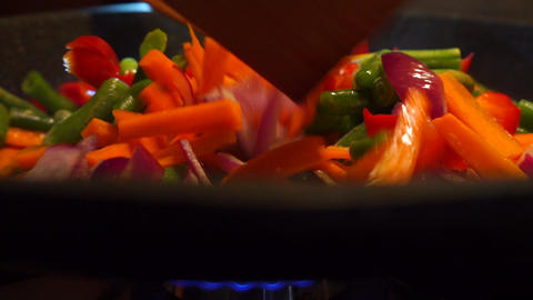 Frying and mixing vegetables close up video Footage