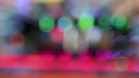 Spinning Illuminated Carousel Lights in Amusement Park Footage