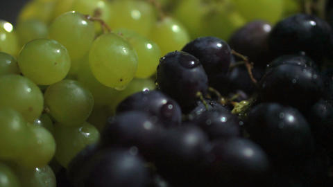 Green and black grape dolly shot, black background Live Action