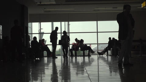 People waiting in the boarding lounge at the airport Footage