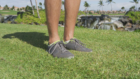 Running shoes footwear in grass park - mens shoes Footage