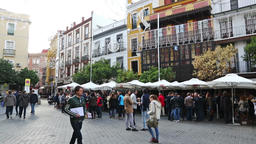 People relaxing and drinking on a street of Seville city Footage
