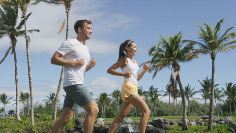 Running young couple in the park training exercise Footage