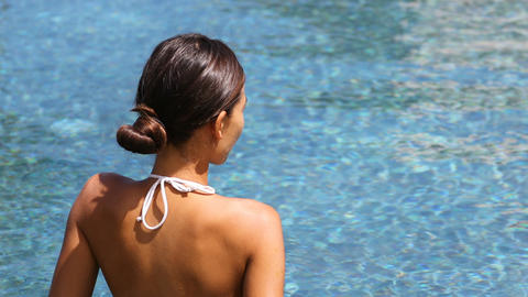 Luxury travel wellness spa retreat woman relaxing in swimming pool Footage