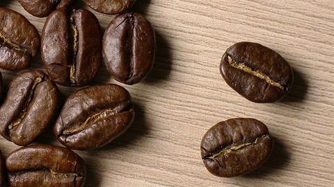 Coffee beans come out of the darkness. Moving shadows Live Action