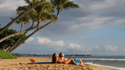 Couple surfing surfers relaxing on hawaii beach Footage
