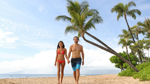 Hawaii holiday couple walking on Maui beach Footage