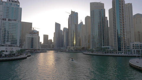 Ship floating on Dubai marina between glass skyscrapers in United Arab Emirates Bild