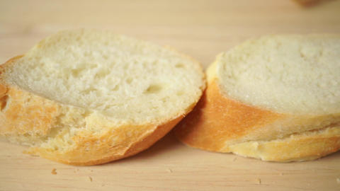 Cut French bread (baguette) horizontal close up dolly shot Footage