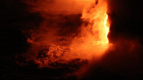 Lava rocks red glowing carried by ocean waves during Big Island volcano eruption Footage