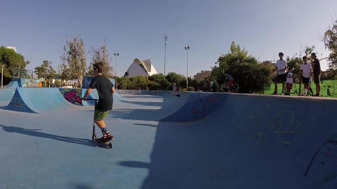 Kids Riding Kick Scooter Tailwhip Jump Flip Air Trick in Valencia Skatepark Bowl 영상물