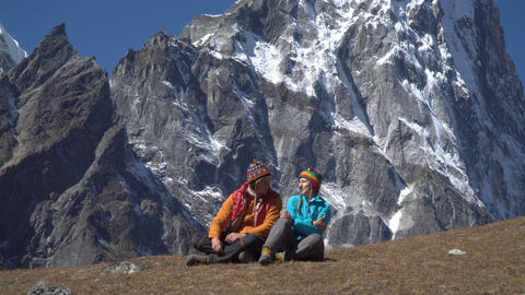 Man and woman in the mountains Footage