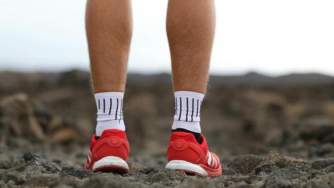 Man running - trail runner training starting running in amazing landscape Footage