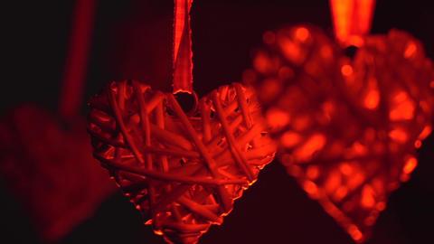 Swinging hanging stylized hearts Footage