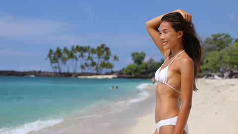 Beautiful Asian bikini girl relaxing on beach living happy beach life Footage
