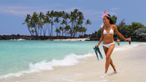 Bikini woman happy having fun on tropical beach with snorkel fins and mask Footage