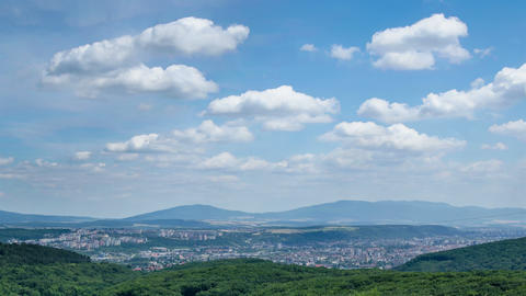 Cumulus clouds rolling over big city in Slovakia time lapse 영상물