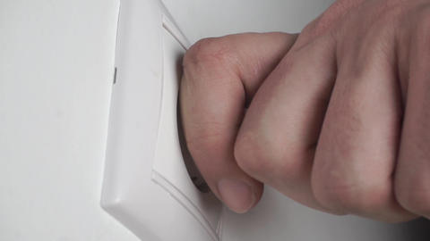 White plug putting into a wall socket and pulling out rapid Footage