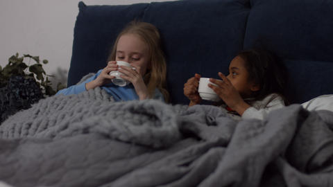 Sick multi ethnic kids drinking hot tea in the bed 영상물