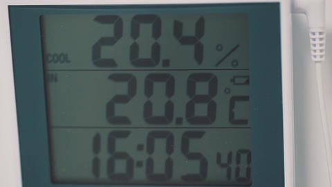 Digital monochrome display with numbers showing temperature and time Footage