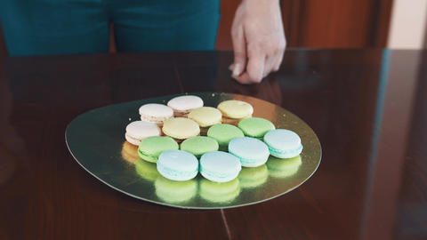 Confectioner female hands squeezes ganache filling making macaron Footage