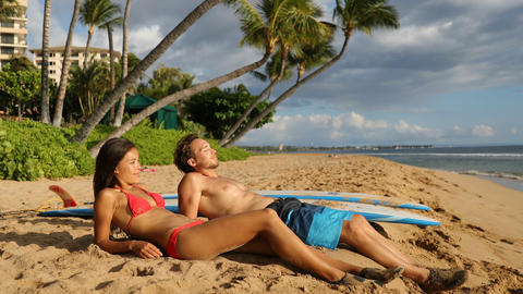 Vacation Couple Sunbathing At Beach Relaxing During Summer Vacation Live Action