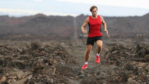 Running Determined Male Athlete Runner Jogging On Arid Landscape Live Action