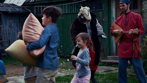 Kids fight pillows in country house. Countryside. Entertainment. Men dance Footage