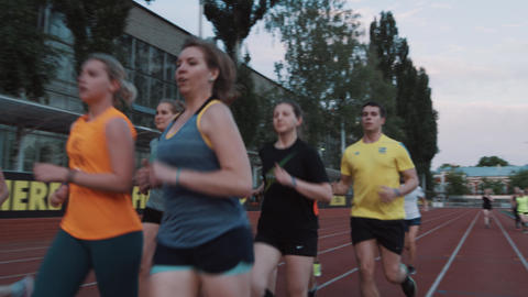 MOSCOW, RUSSIA - JUNE 20, 2016: Athletic people group finishes running session Footage