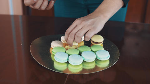 Confectioner woman squeezes ganache filling making macaron Footage