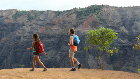 Hawaii hiking - couple hikers on hike in Waimea Canyon Kauai Live Action