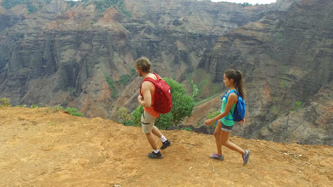 People hiking on Waimea Canyon hike Kauai Hawaii Live Action