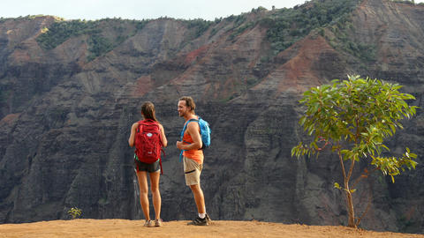 Hiking woman and man walking on hike in Waimea Canyon Live Action