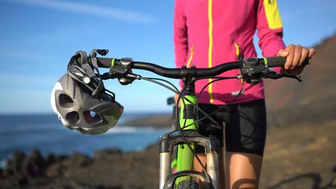 Mountain bike, Woman cyclist and MTB bike helmet closeup Live Action
