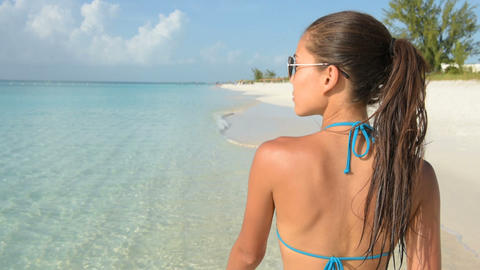Happy beach lifestyle sunglasses girl smiling fun Footage