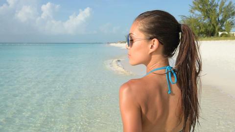 Happy beach lifestyle sunglasses girl smiling fun Stock Video Footage
