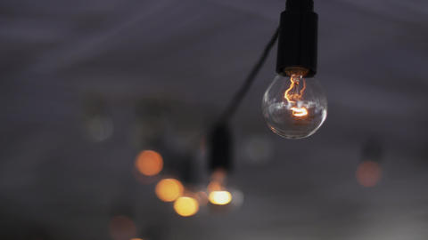 View of lighted light bulbs in terrace of summer... Stock Video Footage