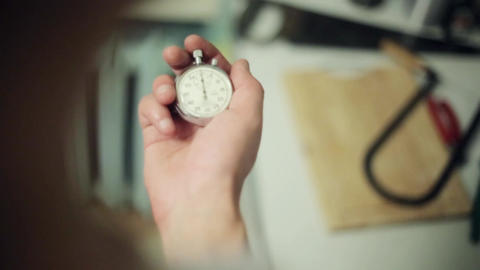 Man hands hold and push button of old round stopwatch Footage
