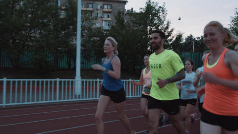 MOSCOW, RUSSIA - JUNE 20, 2016: Happy young people group running exercise at Footage