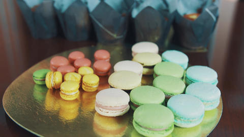 Colorful macaroons and muffins on kitchen desk Footage