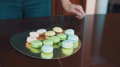 Pastry cook woman hands squeezes creme filling making macaron Footage