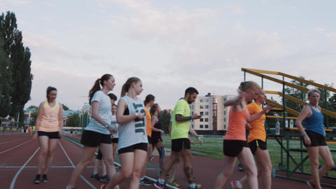 MOSCOW, RUSSIA - JUNE 20, 2016: Sportive people group finishes running session Footage