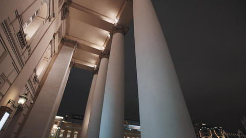 Exterior of Bolshoi Theatre building, lighted up columns on winter night Footage