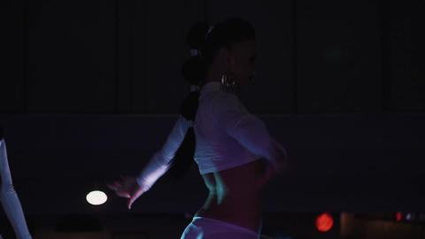 Two go go girls in white bikini dance on stand in nightclub. High heels. Party Live Action