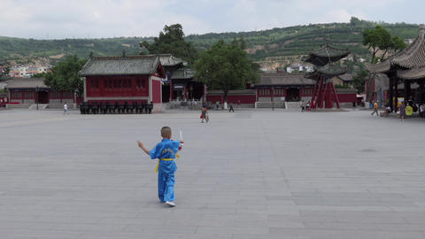 Child Practicing Chinese Martial Arts In City Square China Asia 画像