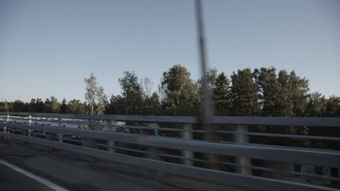 Car go on highway in summer evening. Camera inside car Footage