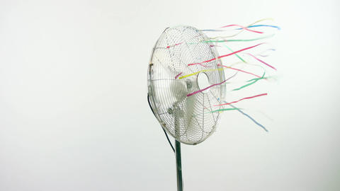 Slow motion of a fan spinning on a white background Live Action