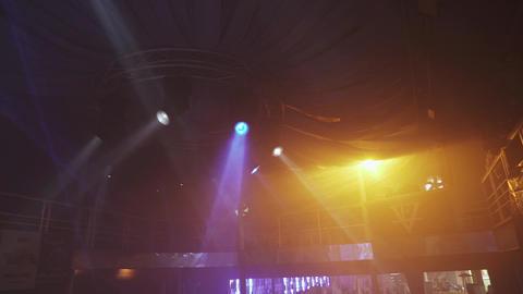 View of hall in nightclub. Rotating conditioner. Orange, blue spotlights. People ライブ動画