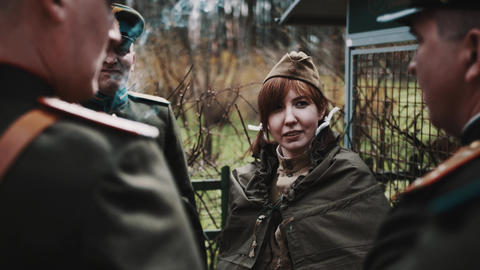 Cute red haired woman in group of men in retro soviet officer un Footage