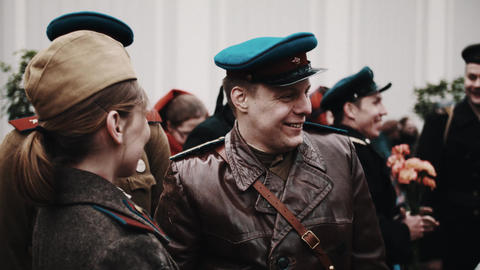 Woman and group of men in vintage soldiers soviet uniform jockin Footage